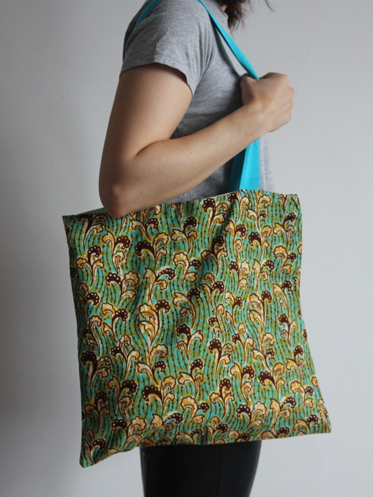 Green and yellow tote bag with blue handle