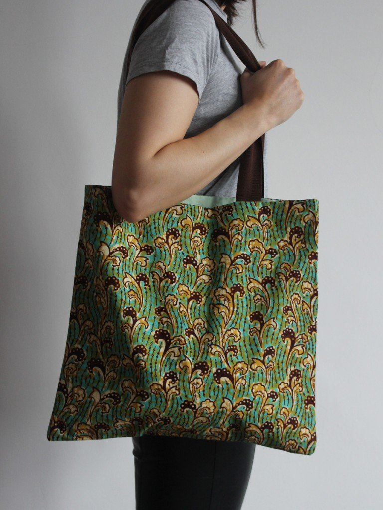 Green and yellow tote bag with brown handle