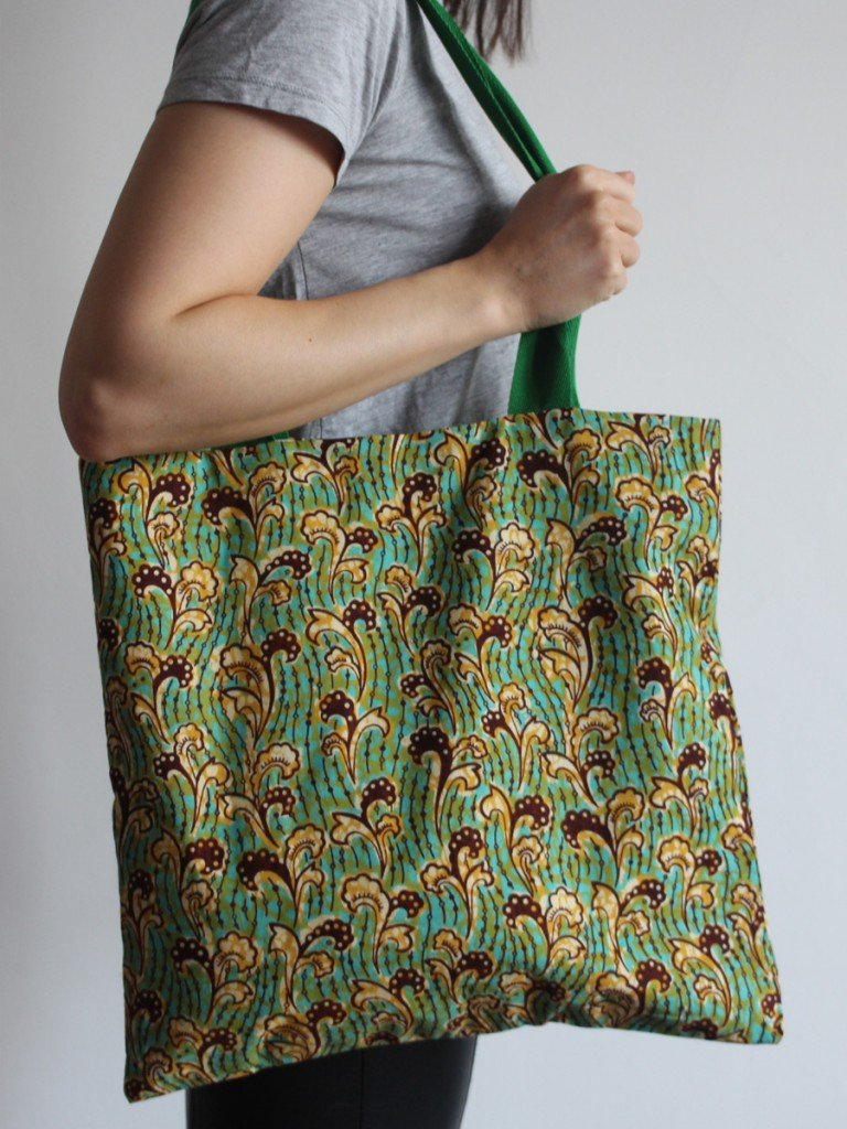 Green and yellow tote bag with green handle
