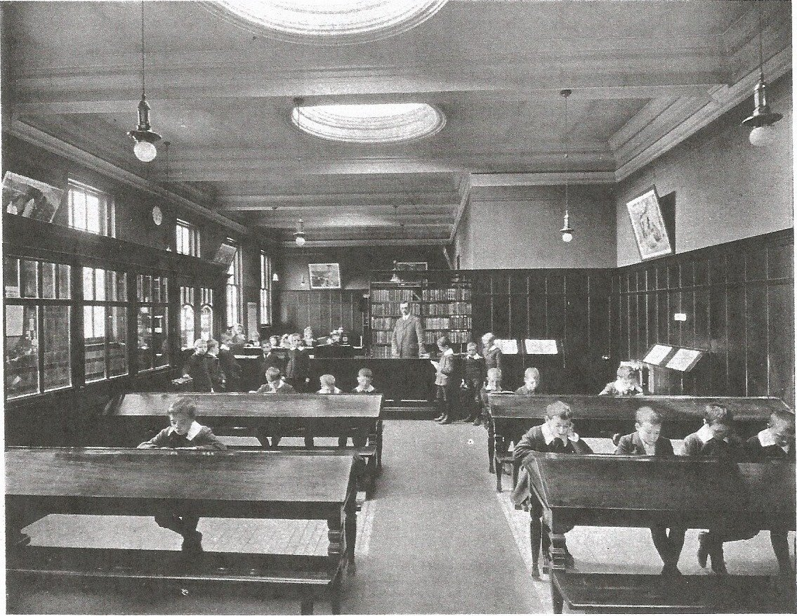 Black and white archival photograph of young boys in library