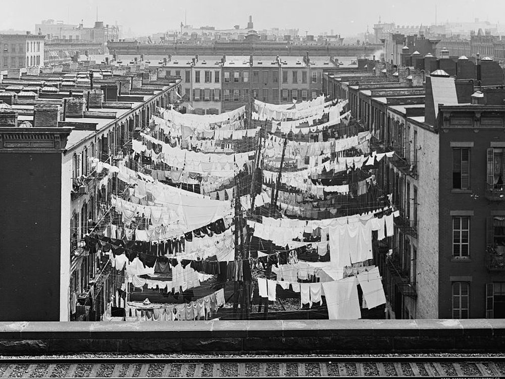 Archival photograph of washing hanging outside tenements