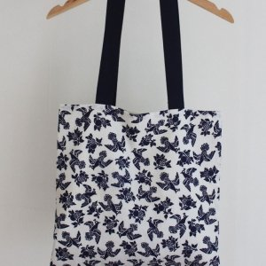 white and blue birds bag