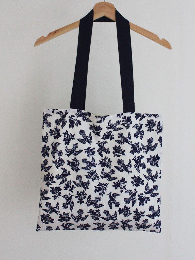 white and blue birds bag