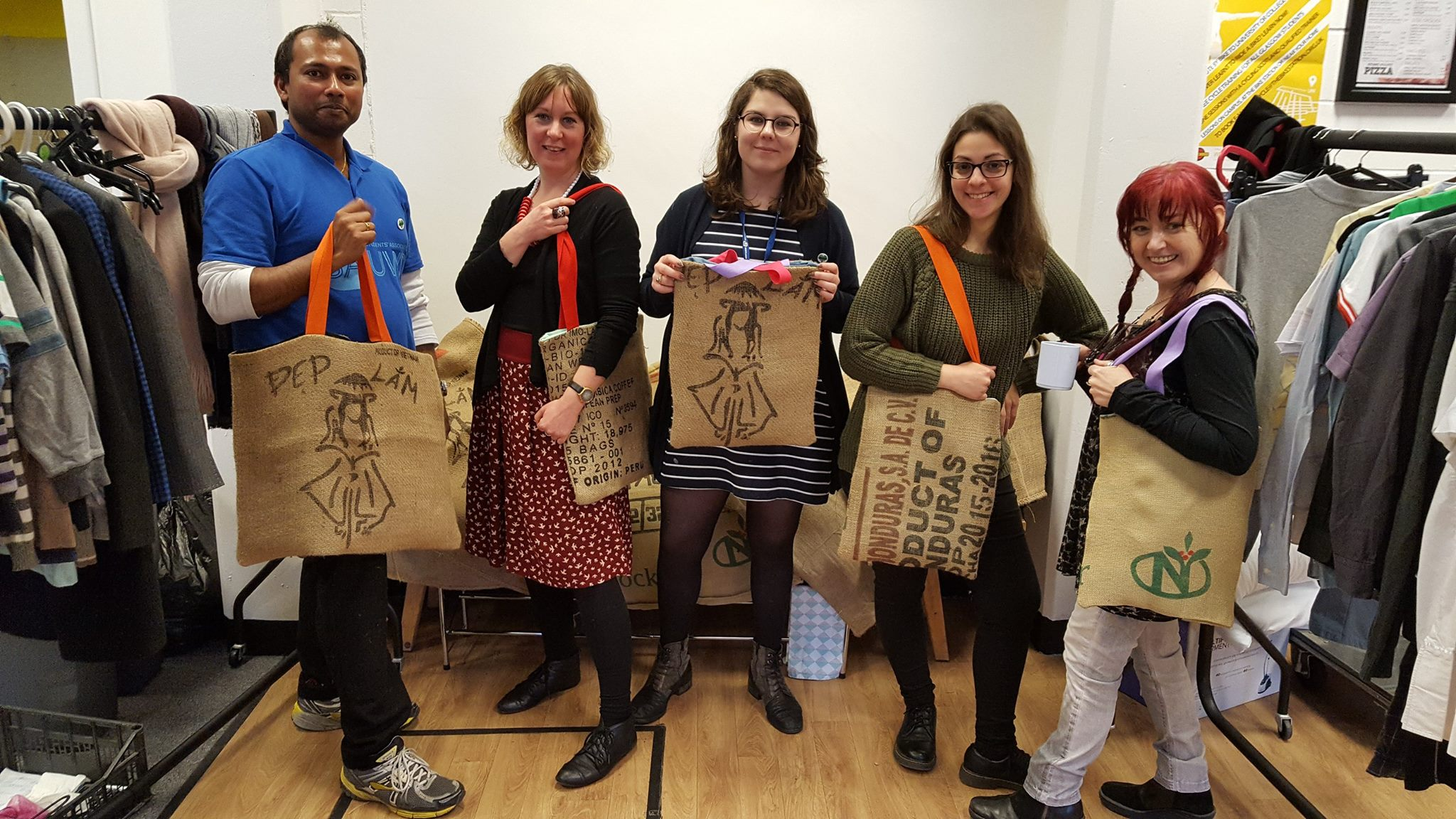 A group of people holding bags