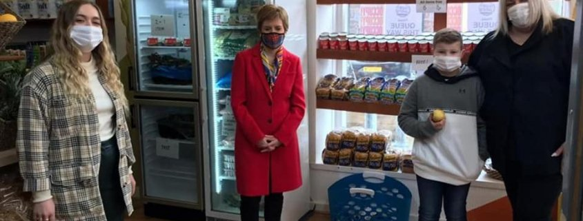 Nicola Sturgeon MSP and staff sanding in food shop